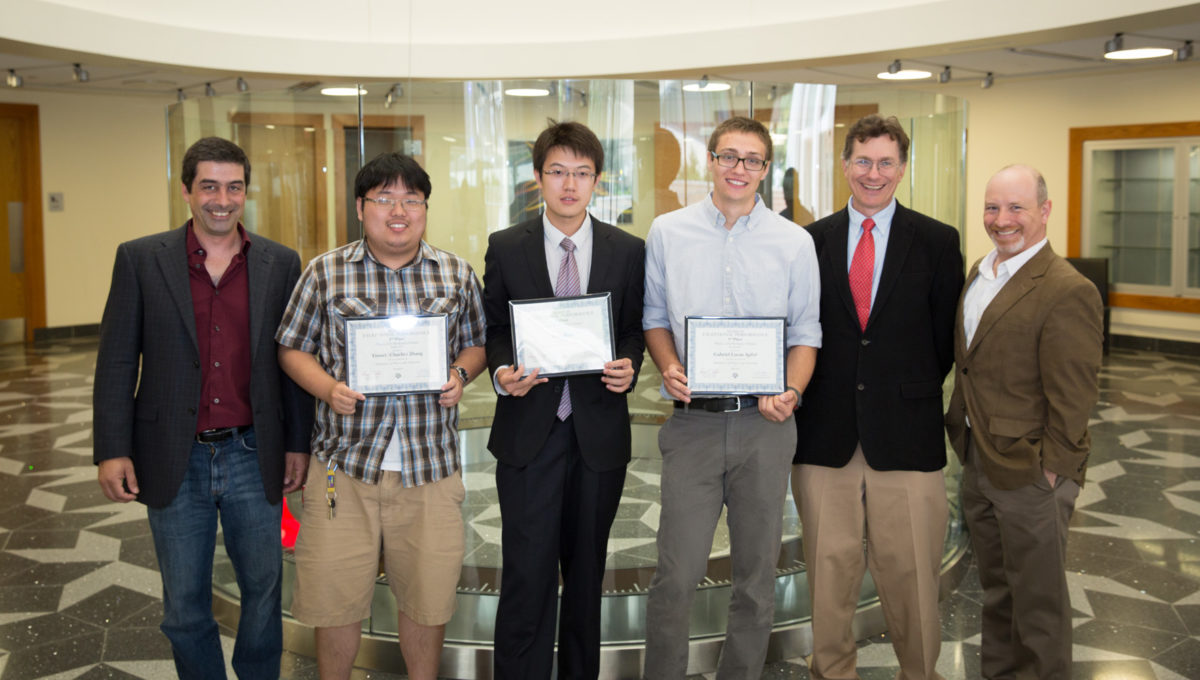 """Top three winners of the Spring 2013 Pearson Mechanics Challenge Exam. From left: Dr. Dan Melconian, Yinwei """"Charlie"""" Zhang (2nd place), Xing Zhao (1st place), Gabriel Apfel (3rd place), Department Head Dr. George Welch and Dr. David Toback."""